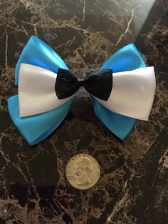 Alice themed hair bow Alice in Wonderland by Jacksonsgoodies