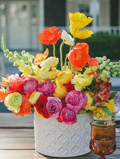 Flowers for Retro Backyard Party  Throw a Retro Backyard Party summer flowers yellow pink and orange - white vases rustic 1960s vintage  ranunculus poppies