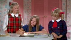 Jan, Marcia, and Cindy making out the slumber party guest list