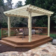 A cozy free-standing deck with shade pergola is an ideal outdoor space for a smaller backyard.