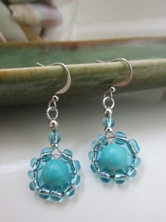 A personal favorite from my Etsy shop https://www.etsy.com/listing/268185401/drop-earrings-with-round-turquoise-bead