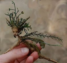 """Spriggan... Could make little """"statues"""" out of carved twigs/branches and plants. Leave them here and there in the garden!"""