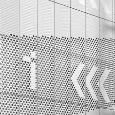 Supergraphic wayfinding in perforated aluminium @hereeast