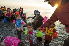 Migrants arrive at at the southeastern island of Kos, Greece, Saturday, Aug. 15, 2015.&nbsp