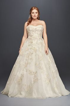 Oleg Cassini Style 8CWG700  Matte organza veiled lace ball gown with beaded lace and 3D floral appliqués. Chapel train.