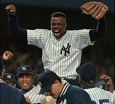 New York Yankees pitcher Dwight Gooden is carried off the field after closing out a no-hitter against the Seattle Mariners on May 14, 1996.