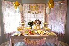 Pink and Gold Twinkle, Twinkle Little Star First Birthday - the twirled crepe paper backdrop is simple to do and adds a touch of sweetness!