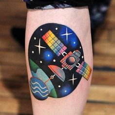 Satellite tattoo on the calf.