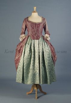Quilted petticoat, England, 1750-1775. Pale ice blue silk satin quilted with large leaf pattern at hem.