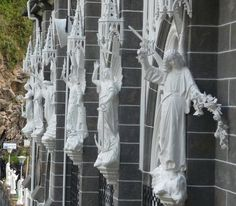 Statues on the cathedral of the Las Lajas Sanctuary, built in 1916 inside the canyon of the Guaitara river, Ipiales, Colombia, where according to local legend, the Virgin Mary appeared.