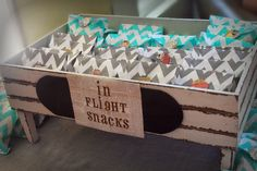 Travel airplane themed baby shower party. In flight snacks chevron bags filled with popcorn