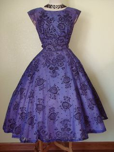 1950's purple-hued cocktail party dress. Blue nylon overdress with embossed black velvet flocking with dotted rhinestones. Lightweight satin lavender/purple underskirt.
