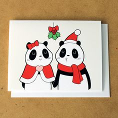 """A panda couple kissing under mistletoe. A good Christmas card for your special someone. :)      Material and How it's made  ---------------------------------------------  Cards are A2 size (5 1/2"""" x 4 1/4""""). They are printed with archival pigment ink on 60 lb premium matte paper that is 11 mil th..."""