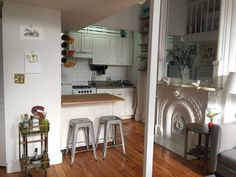 Sarah's Magical Expanding Apartment - love the mix of modern furniture and antique fixtures