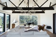 Love the pendant light fixtures.   Consider along periphery of living room beyond loft.   OakPast Guest by Walker Workshop (10)