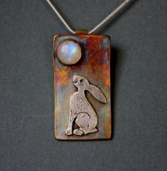 A Moon Gazing Hare Pendant.  Made with fine silver and Moonstone