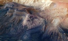 This flat-topped mesa is located in the center of Hebes Chasma on Mars.  Read more: Window on Infinity: Pictures from Space | TIME.com http://science.time.com/2013/11/01/window-on-infinity-pictures-from-space-12/#ixzz2jSSPkmcl