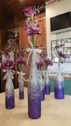 DIY Purple ombre wine bottle vases for centerpieces - different flowers nut still a great idea!