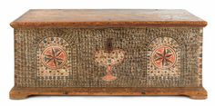"Pennsylvania, probably Dauphin County, painted blanket chest, ca. 1795, the ends decorated with floret and tulip stenciled ovals, the front with similarly decorated panels with central red and green stars flanking a stylized heart, all on an intricately stenciled ground, the interior is fitted with a till and serpentine wrought iron hinges, 22 1/2"" h., 51"" w., 23"" d."