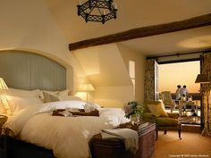Bedroom suite in one of the Courtyard cottages at the Trump International Golf Links & Hotel in County Clare by Ashley Morrison and the ampimage team. Colorful Cafe, Trump International, County Clare, House Beds, Cozy Bed, Luxurious Bedrooms, Resort Spa, Bedding Sets, Comforter