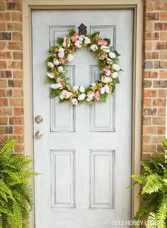 This elegant wreath gives an easy upgrade to any space! We added white and pink tulips to a grapevine wreath form.