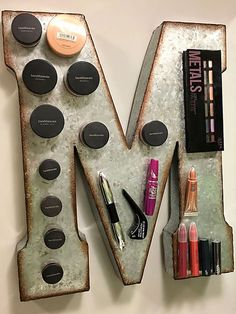 This was my (well my boyfriend's) version of the magnetic makeup board. I didn't have a frame, metal sheets, a way to cut them or anything else. My smart boyfriend suggested using these metal letters. Once I discovered they were half price at Hobby Lobby Makeup Storage Organization, College Organization, Cosmetic Storage, Bathroom Organization, Storage Organizers, Storage Ideas, Organization Ideas, Storage Cart, Hobby Lobby