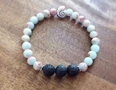 Check out this item in my Etsy shop https://www.etsy.com/listing/515654856/essential-oil-diffuser-stretch-bracelet