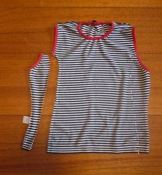 "Refashioning adult t shirt to girl's dress - use elastic at neckline, and sleeves become ""dolman"" style after taking in sides. 3redbuttons blog"