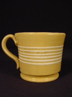 This is a very attractive small mug dating to the The mug is decorated with 6 brilliant white bands. The mug is molded with a finely formed raised foot and applied strap handle. This small mug measures only 3 across the rim by 3 tall. Mccoy Pottery, Vintage Pottery, Pottery Art, Antique Stoneware, Earthenware, Small Boutique Hotels, Vintage Dishes, Cookie Jars, Primitives