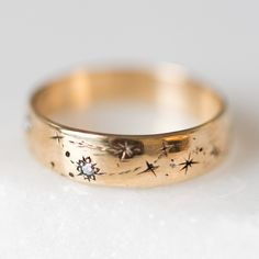 Written in the stars wedding band featuring both zodiac signs