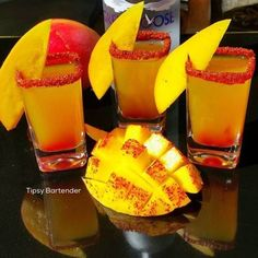 Baby Mango Shots - For more delicious recipes and drinks, visit us here: www.tipsybartender.com