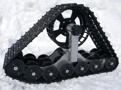 Rubber Track conversion systems for off-road transportation in  snow, ice, wetlands, mud, and other challenging terrain.  Simple bolt-on installation in minutes!