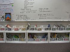 wal-mart cheapie shelves taken apart - line up underneath bulletin board wall and front of the room for classroom library and use school bookshelves for teacher desk materials. no teacher desk - take 2!