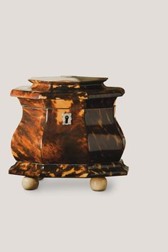 An eight-sided English tortoiseshell tea caddy, about 1820. Tea caddy courtesy of Sallea Antiques; photograph by Doug Todd