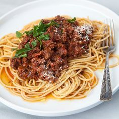 Slow Cooker Bolognese | This Bolognese features a combination of only two meats, ground beef and sausage, but it produces superior results and it's even better the next day. It's great to freeze and have on handfor months.