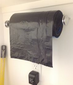 Use a paper towel holder to put your roll of garbage bags on it. Makes it very easy to grab one!! Love this idea. Hope it works, got to figure out how to get it through all the bags in the roll.