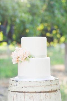 Simply lovely wedding cake set atop a white-washed barrel. #wedding #cake