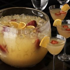 Mimosa Punch,Prep Time:5 mins,Serves:24 glasses ,Directions:Combine orange juice, ginger ale, Grand Marnier, orange slices and strawberries in a large punch bowl. Cover and refrigerate until chilled, 1-2 hours. Right before serving, add the Champagne and ice. Stir to combine and serve immediately.