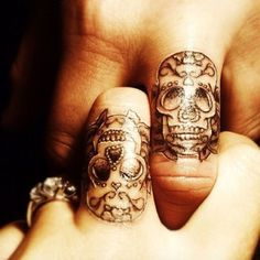 Matching couple/wedding/engagement sugar skull finger tattoos.