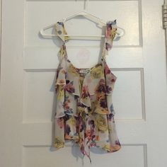 Floral crop top tank Ruffled crop top tank from Forever 21. Worn only once or twice. It's in good condition. Pretty floral pattern for summer. Forever 21 Tops Crop Tops