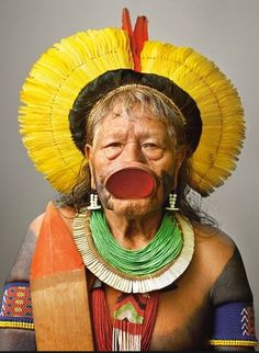 """"""" Raoni Metuktire """" an internationally known chief, is one of the few Kayapo who still wear the mahogany lip plate. Photograph by Martin Schoeller Martin Schoeller, Cultures Du Monde, World Cultures, Guerrero Tribal, Amazon Tribe, Xingu, Indigenous Tribes, Indigenous Communities, Arte Tribal"""