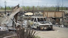 A burnt out van is pictured in the Beacon Hill neighbourhood during a media tour of the fire-damaged city of Fort McMurray, Alta., on Monday, May 9, 2016.