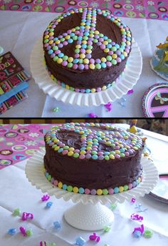 "Peace cake decorated with Easter M & Ms.  Coordinates well with ""peace"" themed partyware found at Party City (and other online stores).  If using a homemade icing that hardens quickly, use a squeezable tube of icing (can buy at store) to add tiny dots of icing ""glue"" to allow the candies to stick. #tween birthday #peace birthday #cake idea #birthday #girl  Photo & design by Stacey Black"