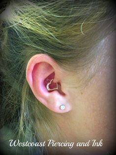 18k Gold Jewelled Heart in this Daith Piercing.  Procedure was done by Julie