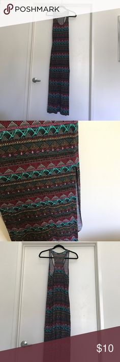 Racer back tank Maxi Dress Aztec print Super cute maxi summer dress or beach cover up. High  side slit on left side, hits above knee. Gently worn and well cared for, no pilling or fading. Slight unnoticeable tear at slit. Dresses Maxi