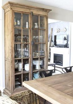 Great way to store all your accessories and decorate at the same time! diy Dining room hutch Our Casual Coastal Style Summer Home Tour Yellow Dining Room, Farmhouse Dining Room Table, Dining Room Hutch, Dining Room Design, Dining Decor, Dining Cabinet, Dining Room Storage, Kitchen Hutch, Dining Room Furniture