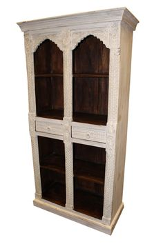 A wonderful white indian style arch bookcase crafted from teak wood and finished in an antique white paint. This piece is perfect for displaying your favourite sets,featuring 4 shelves and 2 Drawers.a strong and sturdy piece. The bookcase is a dark solid teak.