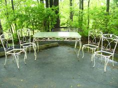Lovely Vintage Wrought Iron Table and four Chairs Patio / Garden Set with Original Glass Top.