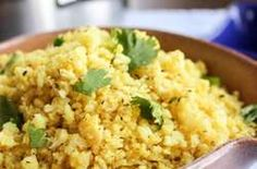 """Indian Spiced Cauliflower """"Rice"""" - from The Food Charlatan. We make a very similar version, veganized by just using olive oil and a splash of hemp oil for earthiness. I also throw in peas because Elby will eat anything with peas in it. Rice Recipes, Indian Food Recipes, Low Carb Recipes, New Recipes, Vegetarian Recipes, Chicken Recipes, Cooking Recipes, Healthy Recipes, Low Carb Indian Food"""