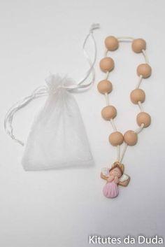 Lembrancinha de biscuit, tema terço para batizado , confeccionados em biscuit aplicados em potinho e muito mais.  Pedido mínimo 15 unidades; R$ 25,00